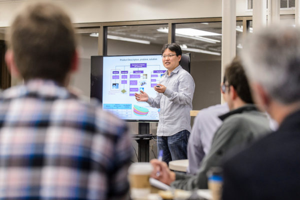 research assistant gives presentation
