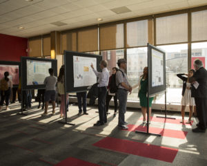 Students present in a poster session