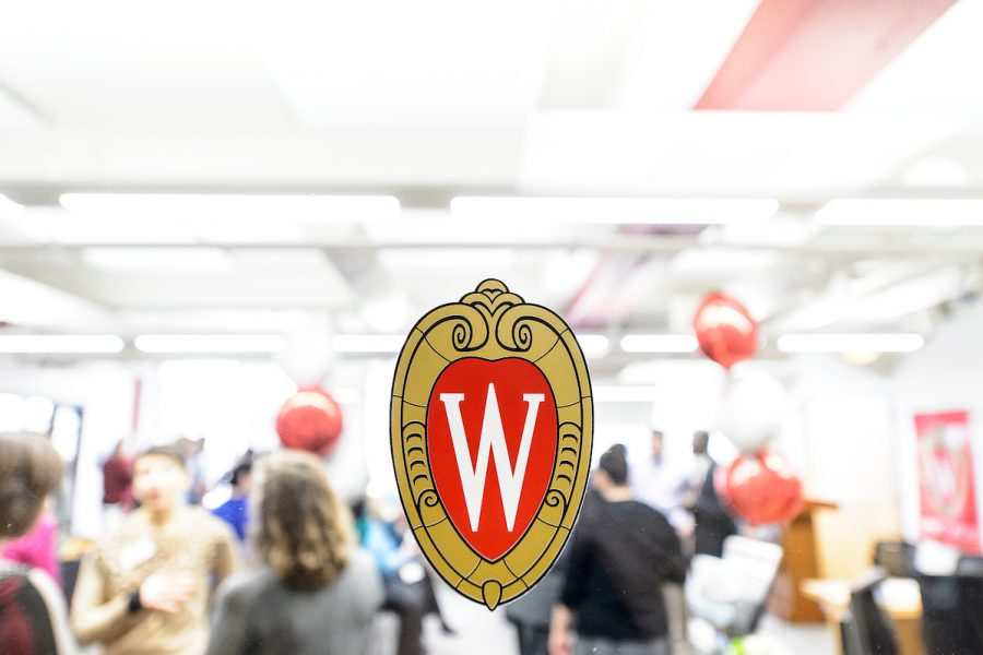 The W crest appears on a glass section of a door outside the Career Exploration Center at UW-Madison.