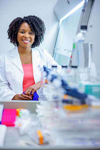 Chantell Evans seated at a lab bench