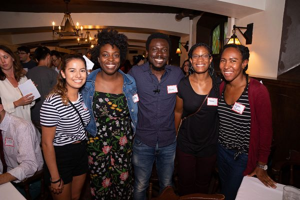 Five students pose for a photo during the Multicultural Graduate Network Welcome Celebration