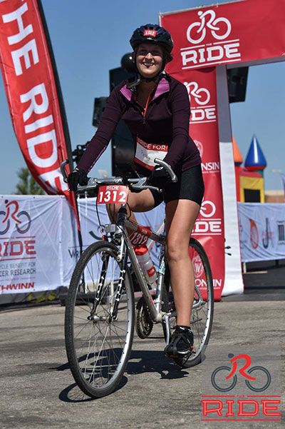 Sydney Jupitz on her bike at the finish line of The Ride