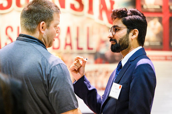 A graduate student speaks with a potential employer