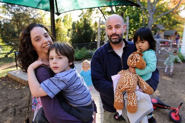A family outside of a campus childcare center