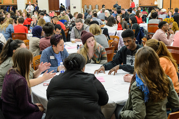 Students at a round table discussion