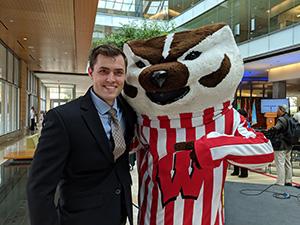 Dylan Schmitz poses with Bucky Badger