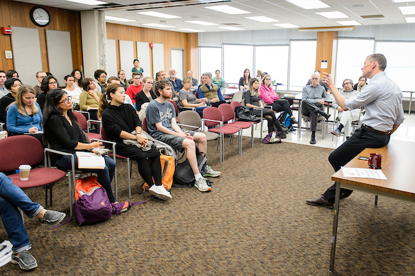 Students attend a talk by a sociology alum